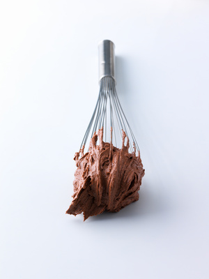 Whisk covered in chocolate